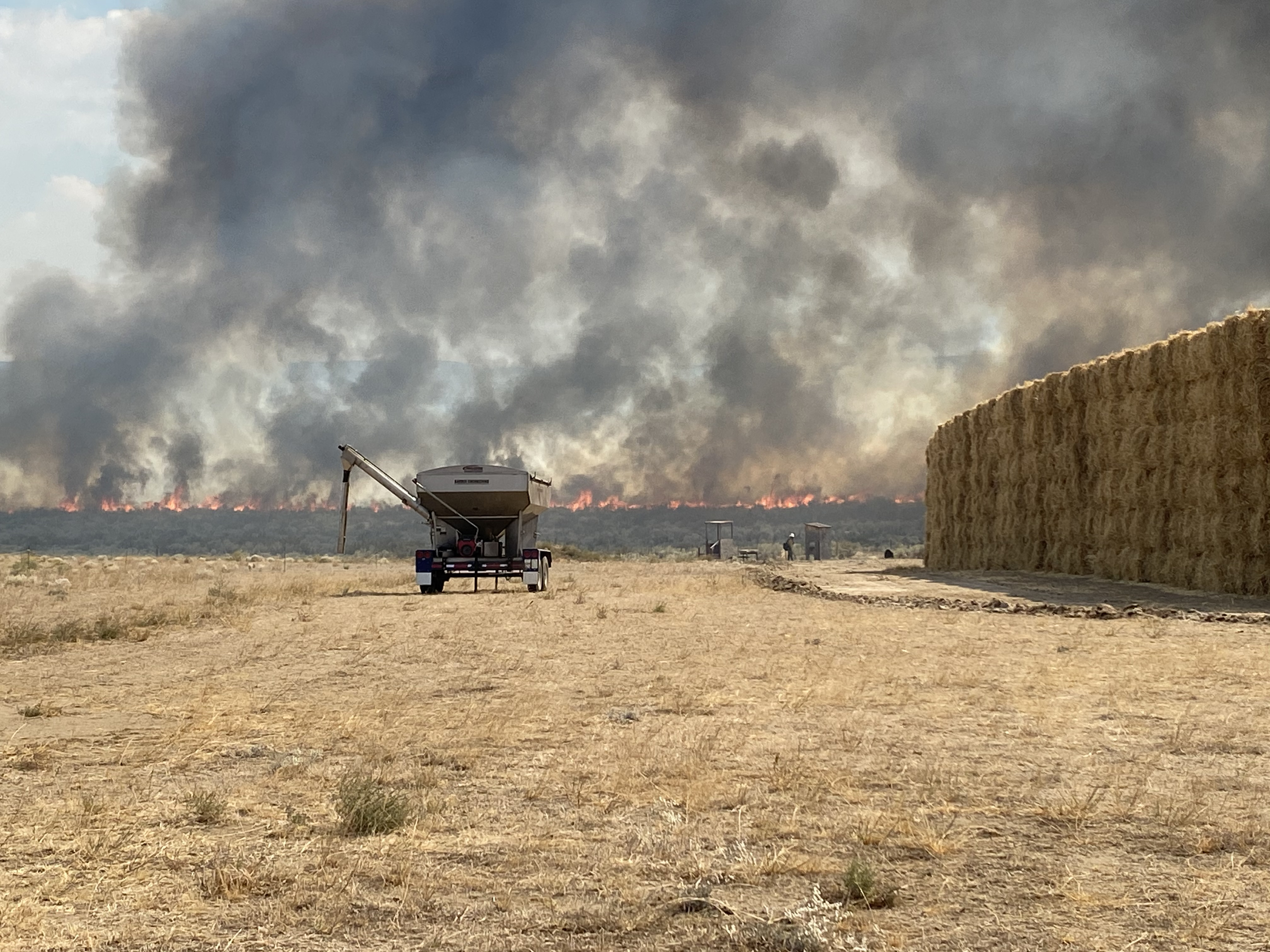 Cold Springs fire heading towards hay stacks
