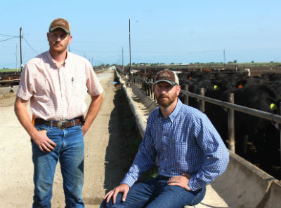 """The Tiffany Boys"" don't really have defined positions in the feed yard but if roles were to be assigned Shawn (left) would be operations manager and Shane (right) would be business manager. Shane explains that he makes the promises and Shawn carries them out."