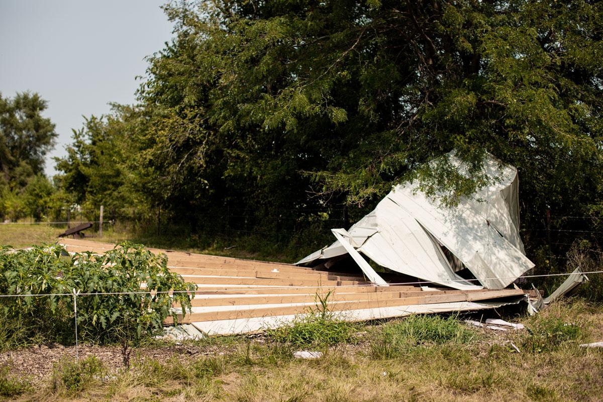 Ken Hartzell barn roof laying on grass